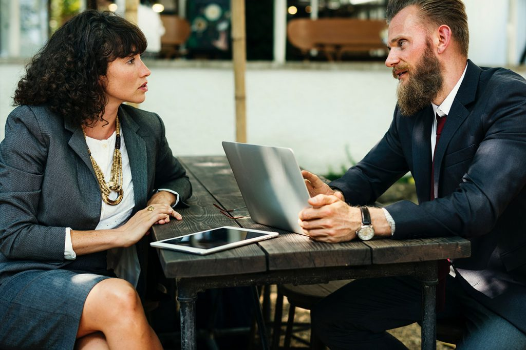 Professional Services Website Man and Woman Meeting