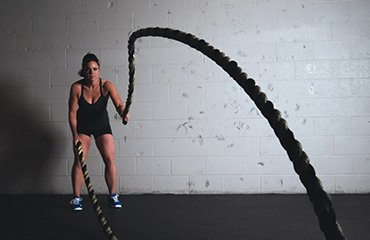 Lifestyle Gym Website Woman Doing Rope Workout